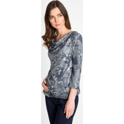 3c5967de79 Metaliczna bluzka w kwiaty QUIOSQUE. Bluzki marki QUIOSQUE. W wyprzedaży za  66.00 zł.