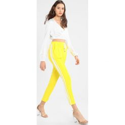 17b007c7dd Missguided DOUBLE SIDE STRIPE Spodnie treningowe yellow. Żółte spodnie  dresowe Missguided