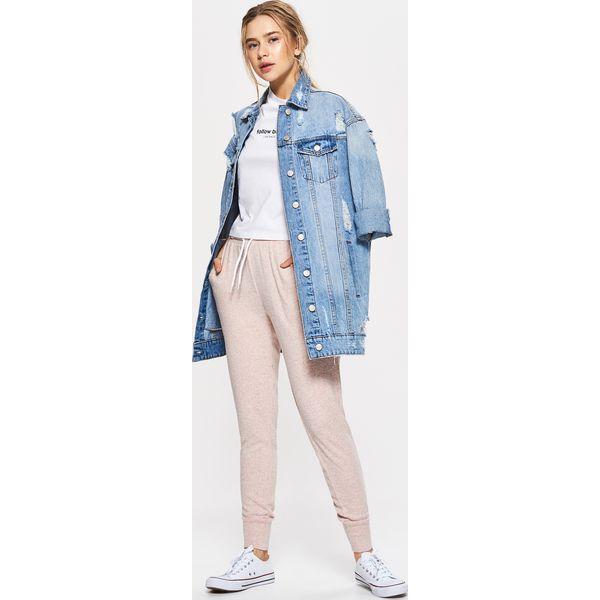 81a8069a41a0 Dresowe joggery - Różowy - Spodnie dresowe marki Cropp. W wyprzedaży ...